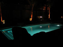 Image of an In-ground Fiberglass Pool Installation at Night in the GTA