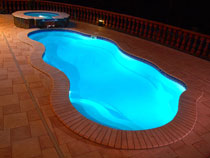 Image of an In-ground Fiberglass Pool Installation at Night in Ontario