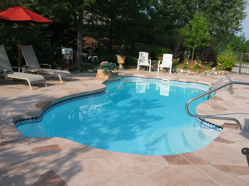 Image of In-ground Fiberglass Pools Installation in Residential Backyard Toronto & the GTA