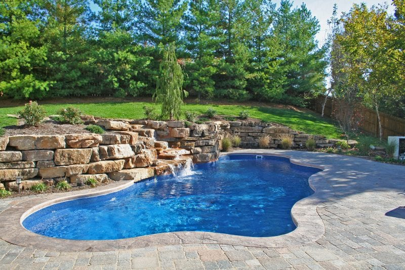 Image of Free-form In-ground Fibarglass Pool with Rock Formation in Toronto & the GTA