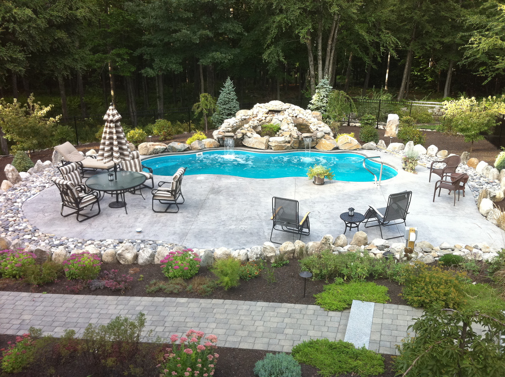 Image of In-ground Fiberglass Pool in Backyard with Rock Formation Waterfall in Ontario